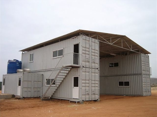 Huge shipping container shed using 4 forty foot containers and a prefab  roof with stairs and
