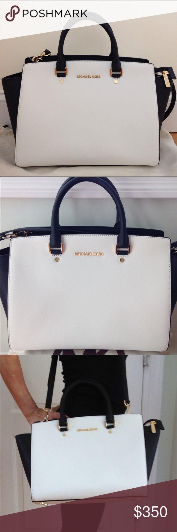 "Michael Kors - Elegant and classic handbag 100% Saffiano leather. Gold tone hardware 14'W x 9""H x 3.5""D. Handle drop 4.5"". Adjustable strap 17.5""-19.5"". Interior zip pocket 3 open pockets plus cell phone pocket. Pockets lining polyester. Michael Kors Bags"