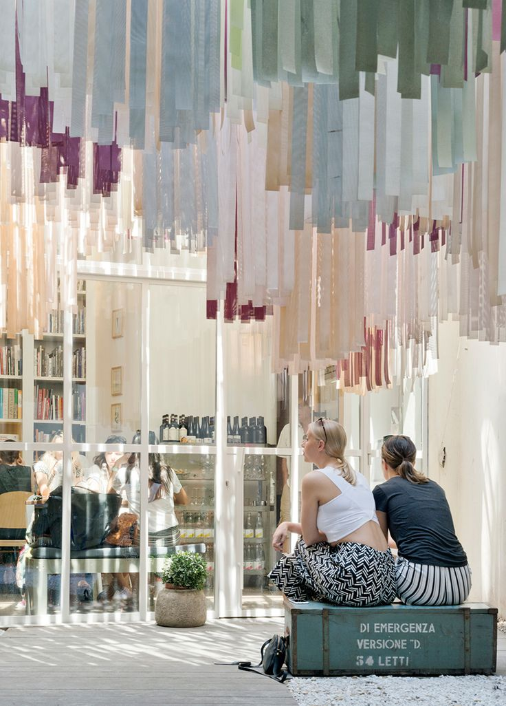 brac bookstore + café in florence features an undulating canopy of 5,000 fabric strips