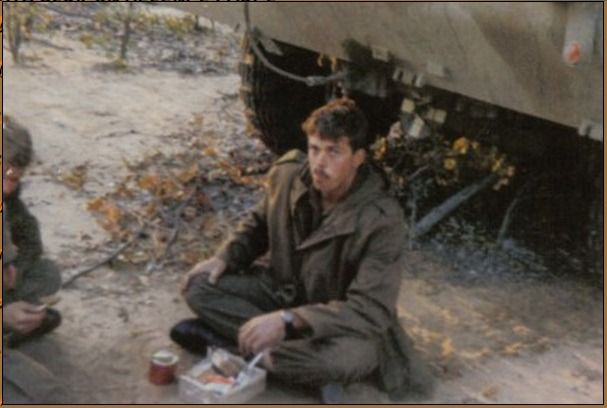 A troop enjoying the feast from a ratpack in Angola, the enjoyment plain on his face.