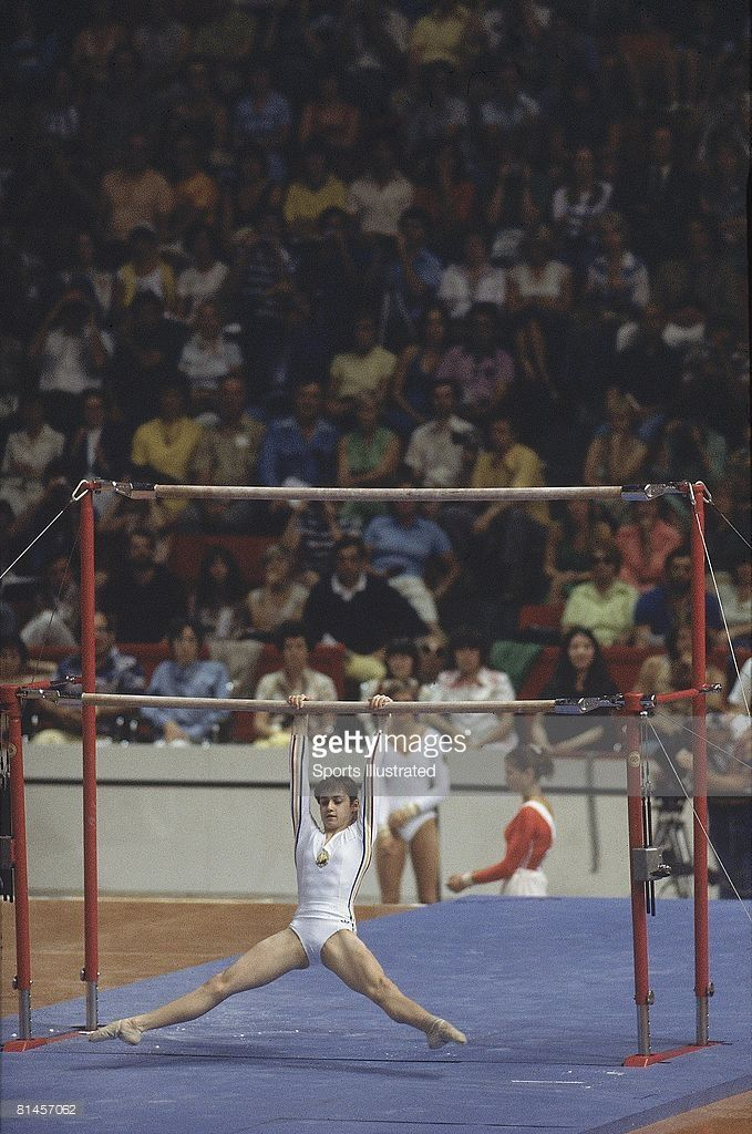 1976 Summer Olympics, ROM Nadia Comaneci in action during uneven bars competition, Montreal, CAN 7/17/1976--7/31/1976