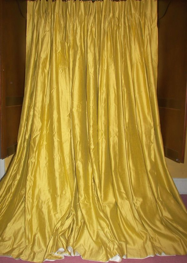 Fabric is not thick, it is medium weight drapery fabric, silky and luminous. Victorian baroque gold. UNSURE OF FABRIC CONTENT, FABRIC HAS VIBRANT LUMINOSITY LIKE A SILK FABRIC, BUT I CANNOT BE CERTAIN (no tags).