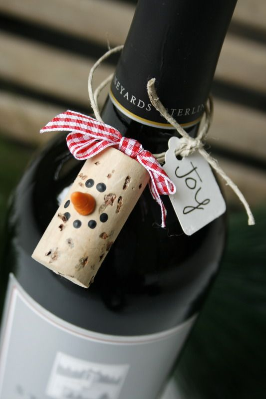Cork gift tag - eye screw at the top, painted face, FIMO clay nose.  Can picture a cute Rudolph too.