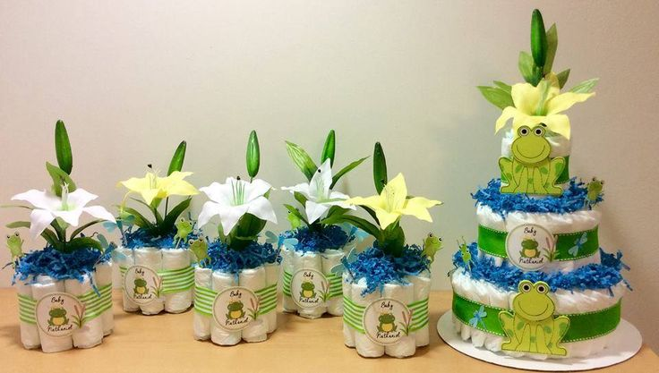 Frog themed baby shower.  Diaper Cake and 5 centerpieces.  Like what you see?  Follow me on FB  www.facebook.com/MisawaGiftCakesbyTasha