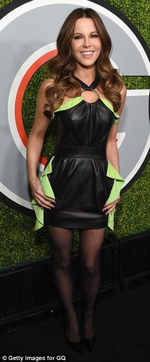 Stylish: The British actress wore a black leather mini dress with a halter neck. The number had lemon yellow detailing on the bodice and the sides of the skirt and a gold ring at the neck