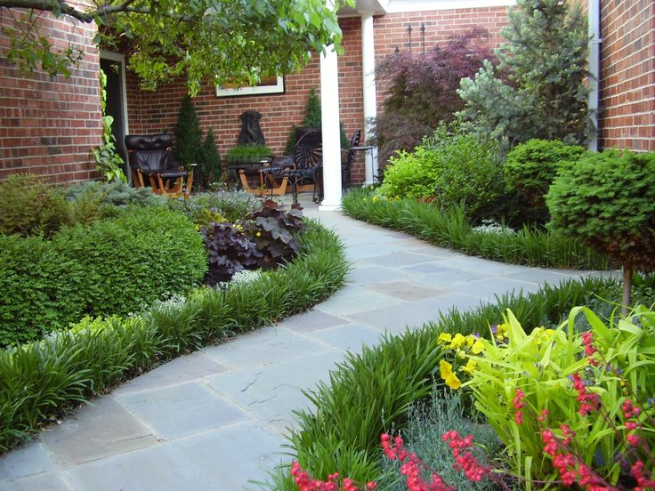 Slate walkway lilyturf border front bed pinterest for Blue slate garden designs