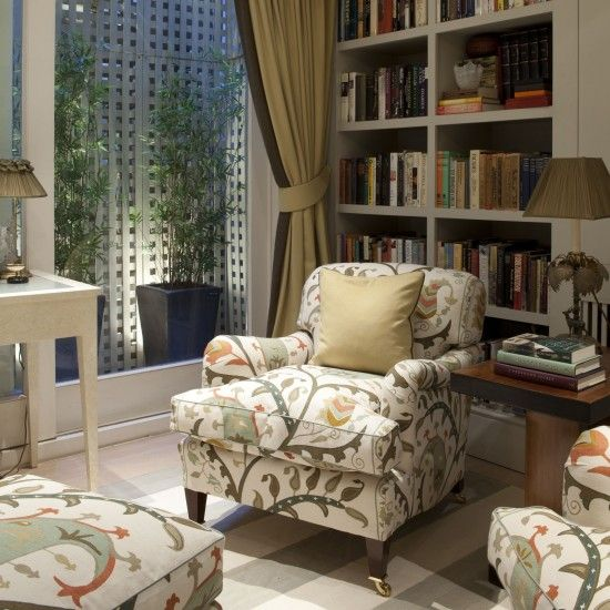 Nina Campbell:  TV room in the basement of my house. The armchair is upholstered in the Beatrice Fabric from the Paradiso collection