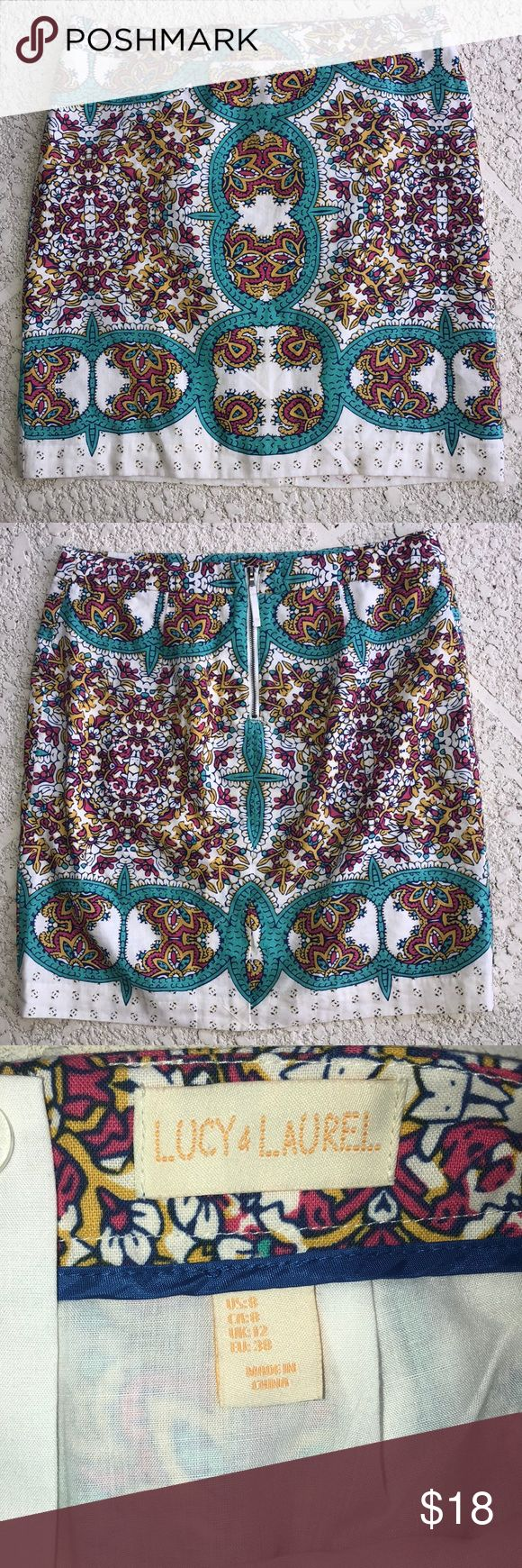 """🆕 Lucy & Laurel floral print skirt EUC Anthro Beautiful lined skirt  White background with graphic floral print on turquoise, yellow, navy and magenta. Linen and cotton skirt, lining polyester and cotton. Approximately 19"""" long Waist is approximately 16"""" across. Anthropologie Skirts"""