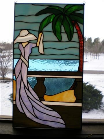 Lady #2  Freehand design set in stained glass. classy lady overlooking ocean with palm tree