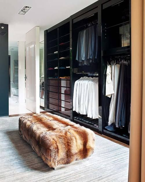 FUR covered bench ups the cool factor in this classic dressing room w/its cabinetry painted in black