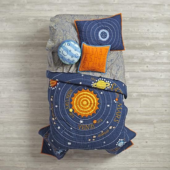 "Let the countdown to bedtime begin. Our out-of-this-world Solar System quilt features our eight official planets orbiting the sun. Feeling sorry for Pluto? We've paid homage to the cute dwarf planet in a top-of-the-bed, reversible throw pillow. Complete the universe with our 200 thread count printed star comforter cover, sheet set and shams. Don't forget a ""Blast-Off"" throw pillow.<br /><br /><NEWTAG/><h2>Details, details</h2><ul><li> A Michael Mabry design</li><li> Quilt and Comforter…"
