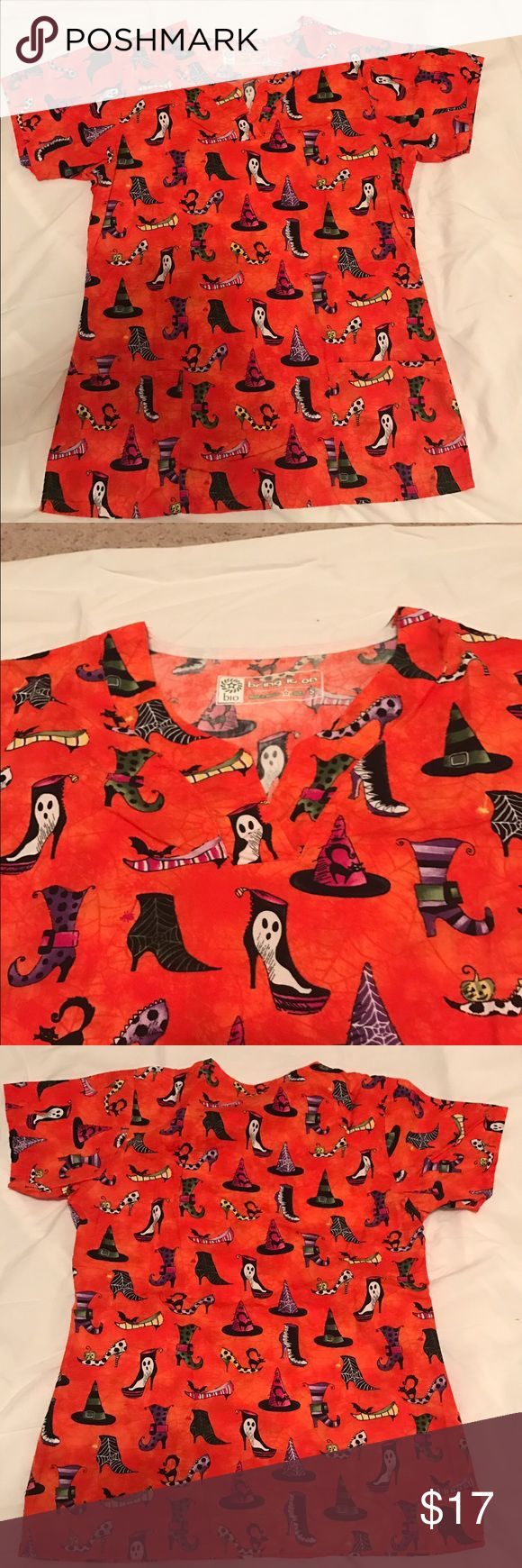 """Sassy Halloween Witch Hats & Heels Scrub Top Orange Halloween V neck scrub top with 2 pockets. Size S. 19.25"""" across front. Excellent condition. Price firm unless bundled. Bio Tops Tunics"""
