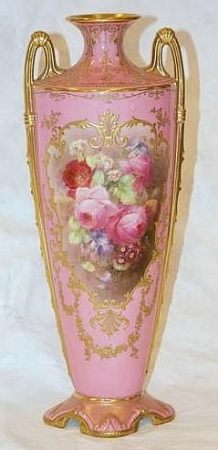 Royal Doulton vases, painted by Percy Curnock, circa 1910 one two handled pink ground vase with panels of roses, the other with bees and poppies.