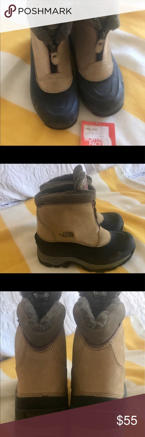 "North Face ""Chilkat"" waterproof, insulated boot. Never worn, with original tag. The North Face ""Chilkat"" waterproof, with 'Thinsulate' Boot. Zipper closure. Great for walking in cold weather or ""apres ski""! Tan with black bottoms. The North Face Shoes Winter & Rain Boots"