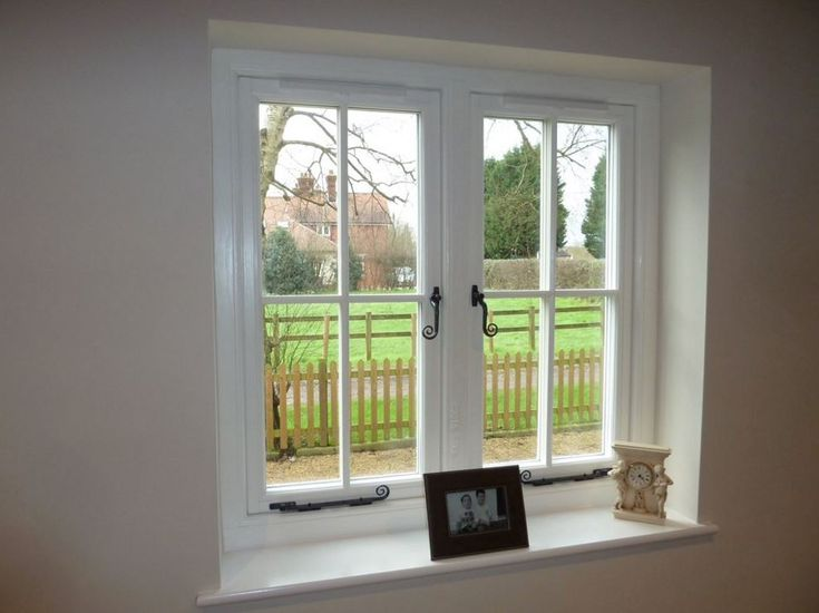 Residence 9 grained white windows with monkey tail handles