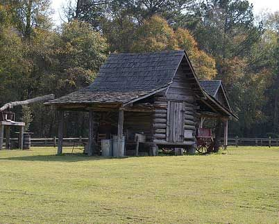 "(ALABAMA) Dothan's Landmark Park, the official state agricultural museum. Features of the 100-acre park include an 1890s living history farm, a one-room schoolhouse, a general store, a turn-of the-century church, elevated boardwalks, nature trails, wildlife exhibits, a planetarium, ""barnyard playground"" and a picnic area."