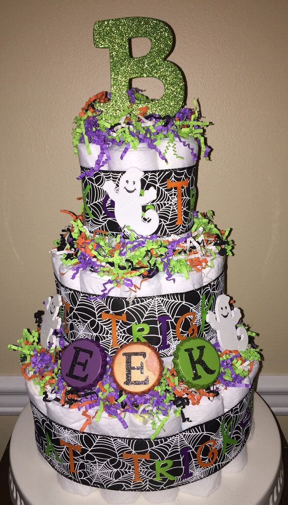 This spooktacular Halloween diaper cake is ready to ship! Perfect for a baby boy or girl or gender neutral shower theme. This diaper cake