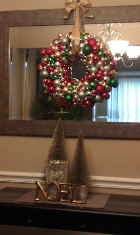 Ornament wreath I made for the holidays.  Unfortunately, it was too thick to fit between my front door and screen door, so it had to go over the mirror in the living room.  Still love it!