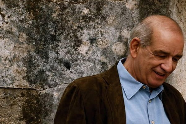 Listen to a great Greek singer's song. (Dimitris Mitropanos buried today)
