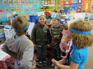 """Using the game Hedbanz with sightwords- just write them on an index card. Here is how it goes....the boy in the grey sweatshirt is """"it"""". The children starting with the cutie pie in the blue shirt spell the word on his headband & he has to guess his word. If he guesses he picks the next person to be """"it"""" & then they spell their word. After everyone gets done then WITHOUT looking they flip their card over & start over until it's time for a new card."""