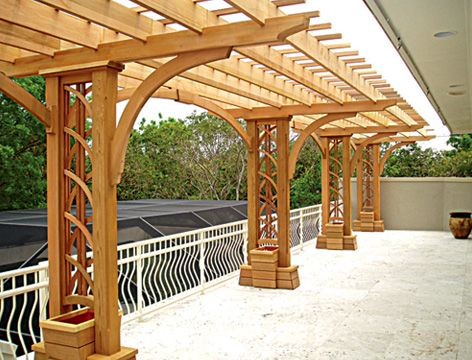Contemporary Pergola.  I love this.  Just needs some climbing flowers growing up it.