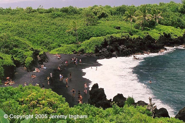 Hana, Maui, HI - black sand beach. The whole trip was amazing but the highlight was Hana with its beautiful rainforest, lava tubes, beaches, and flooded caves.