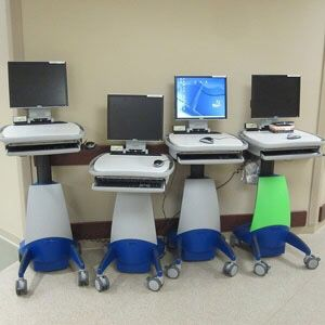 (50 words or less)  A work station on wheels is exactly what it sounds like! It is a wireless computer station on a cart, with wheels! It also has buttons to adjust the height of your station! With this design you can take your work with you, anywhere in the hospital.