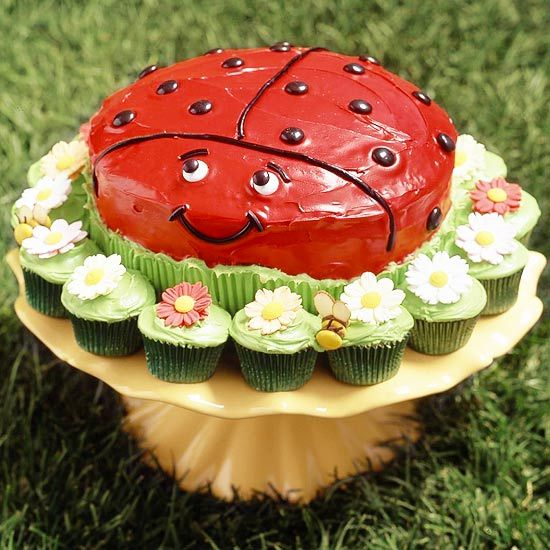Lucky Ladybug Cake-love the little flower cupcakes around it, but I would HATE to make all that red frosting!