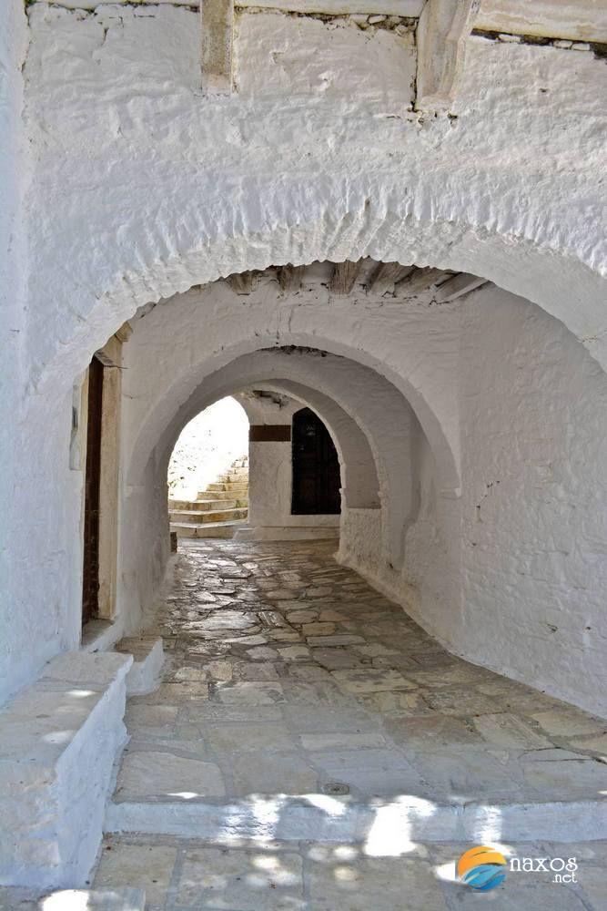 Sheltered pathways of Apeiranthos leading to private homes.