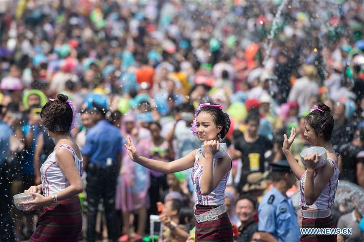 Local residents and tourists have fun during the water-splashing festival in Jinghong City, Dai Autonomous Prefecture of Xishuangbanna, Yunnan Province, April 15, 2016.  http://www.chinatraveltourismnews.com/2016/04/dai-ethnic-new-year-celebrated-with.html