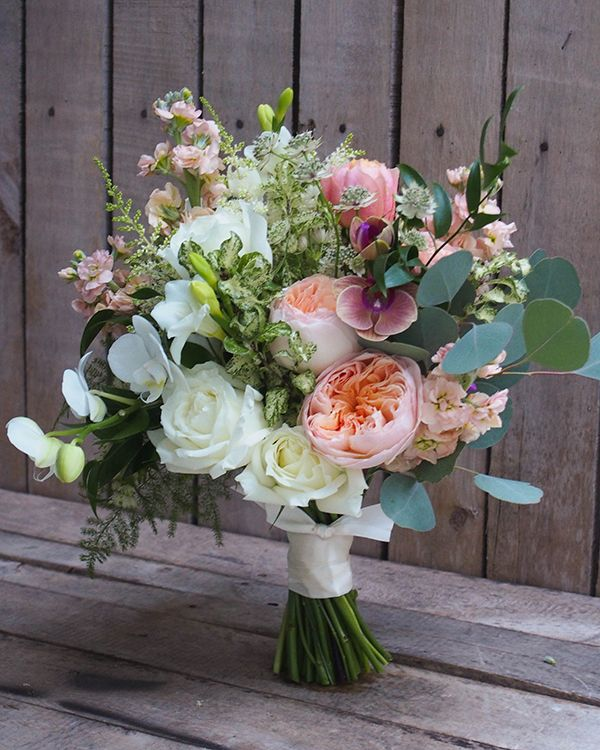 Peach David Austin rose bouquet with orchids, roses and foliage // Everything You Need to Know About Peonies for Your Wedding