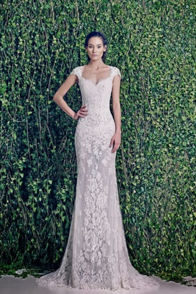 This makes her look 7 ft tall but i like the dress.  WEDDING DRESSES: ZUHAIR MURAD BRIDAL FALL 2014 - Fashion Diva Design