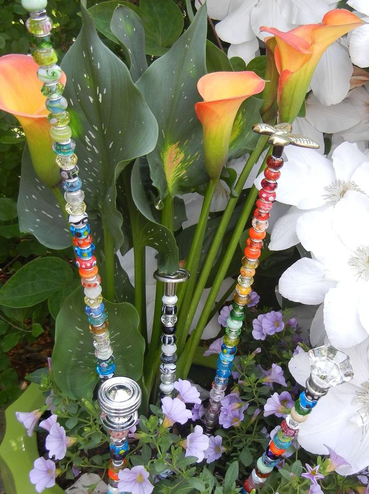 Diy fairy wand garden stakes...threaded rods, bracelet beads, drawer knobs.