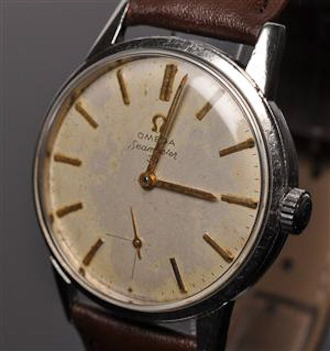 Vintage Omega Seamaster. Sometimes you can pick up pretty battered omega watches (or the watch minus the strap) on trademe for cheap and just slap on a leather strap and a new battery?