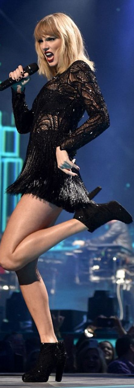 Who made  Taylor Swift's black ankle boots and fringe dress?