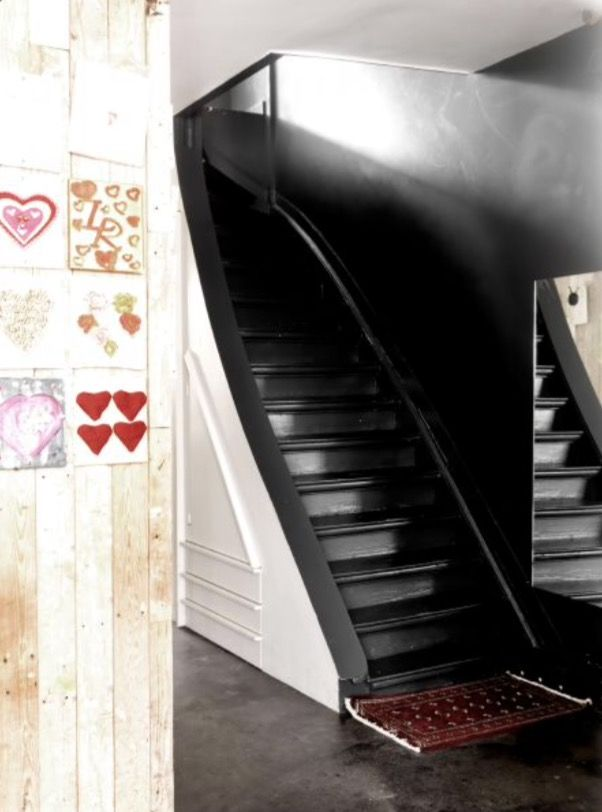 "This marvelous black staircase is from our feature ""Urban Cool"""