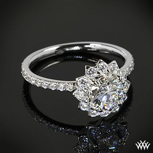 """Leon Mege designs, This """"Lotus Halo"""" Diamond Engagement Ring by Leon Mege is set in platinum and holds 0.72ctw A CUT ABOVE® Hearts and Arrows Diamond Melee. The flower design halo surrounds a beautiful 1.095ct A CUT ABOVE® Diamond."""