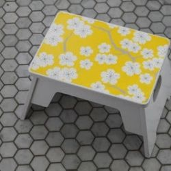 Dress up a plain stool or a great way to hide the top