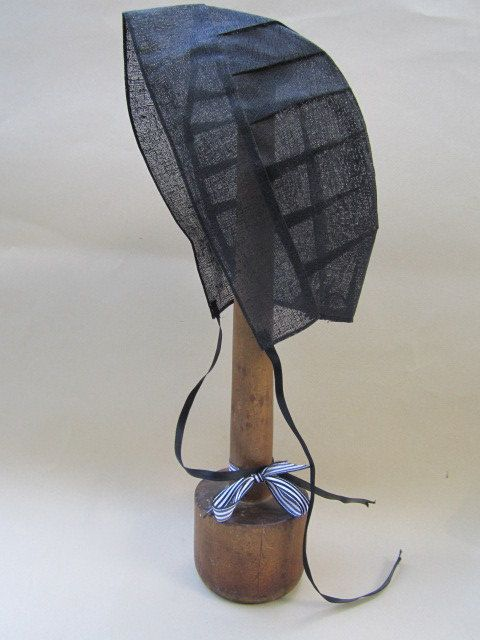 Wooden hat stand with Amish Bonnet.