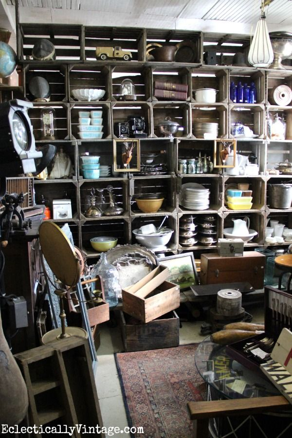 Antique store booth eclecticallyvintage.com ~ I just love the crate storage wall!