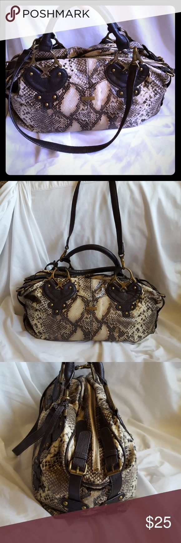 """Large Jessica Simpson Snakeskin Bag Cute """"snakeskin"""" bag with double handles and removable shoulder strap. Bag measures 16"""" wide x 9"""" tall x 7"""" deep sides that expand. Handles add 5"""" to height or shoulder strap adds 14"""" to height. Zip closure.  Bag has 1 interior zip pocket and 2 smaller accessory pouches.   Good used condition.  A couple small signs of wear - see zoomed in pic of front label plate.Barely noticible with snakeskin pattern.  Smoke free and pet free home. Jessica Simpson Bags"""