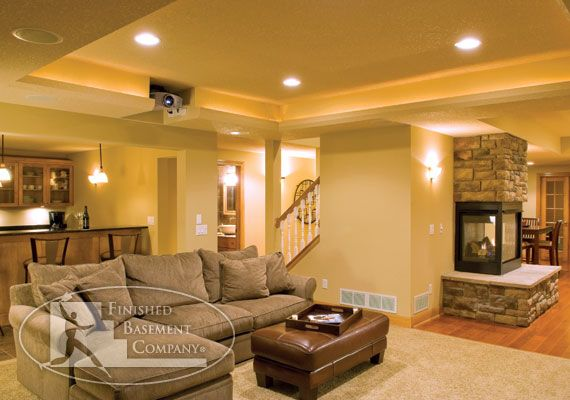 Basement Family Entertainment Room- has my bar, big couch with projector for movies, and a table and pool table/ gaming area at other end. I would never resurface. The doorway next to the bar  could lead to a bathroom and additional bed rooms.