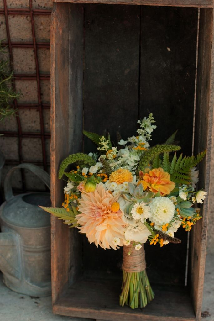 Early September featuring dahlias, cosmos, feverfew, tansy, ferns, millet, hydrangea, succulents, and more.