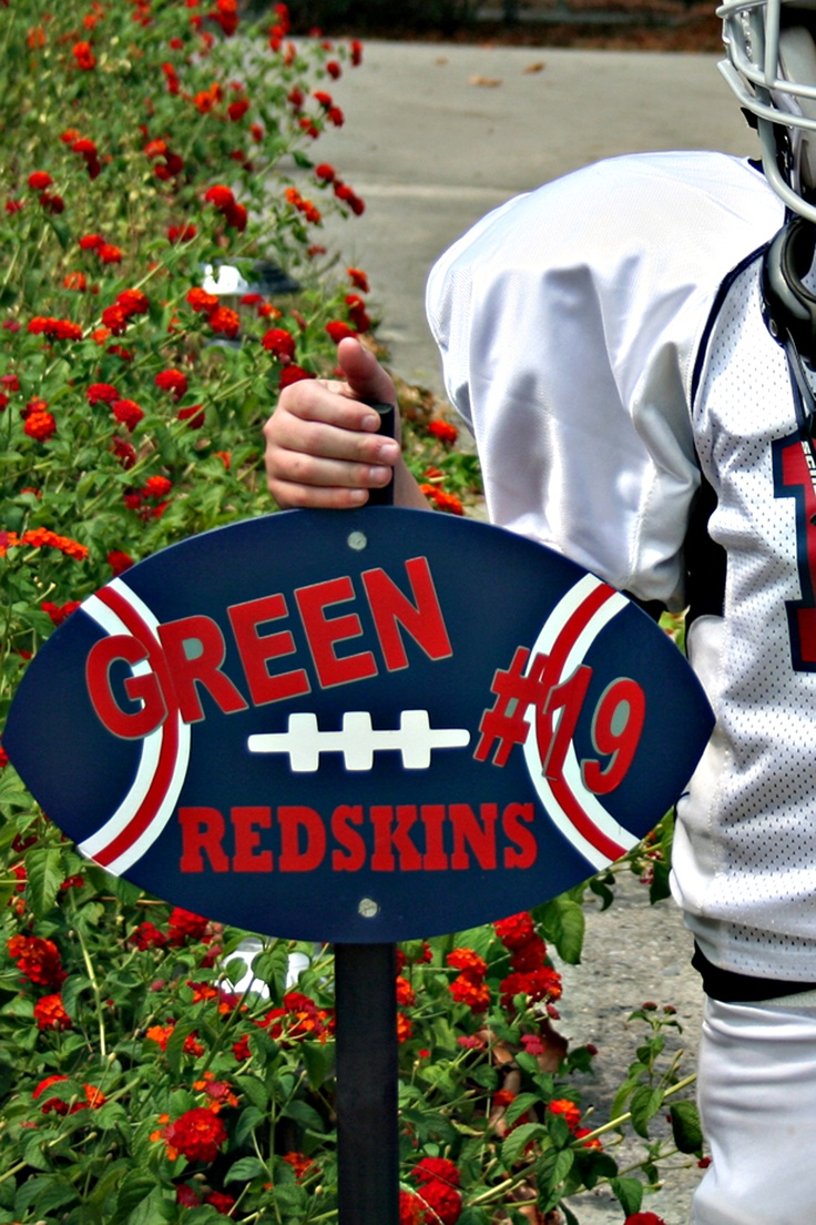 Football made by me, my mom, and my husband.  This is my son's football we have in our yard.  My husband cut the football out of wood.  My mom painted it with outdoor paint, I cut out the vinyl letters with outdoor quality vinyl, clear coated it a few times, and then my husband attached it to a stake.  So far, I've made one more, and currently working on two more.