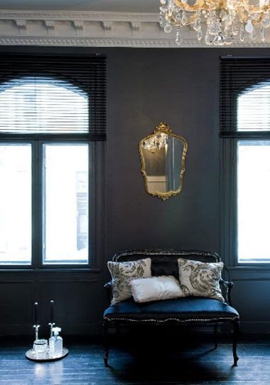 White crown moldings and dark walls