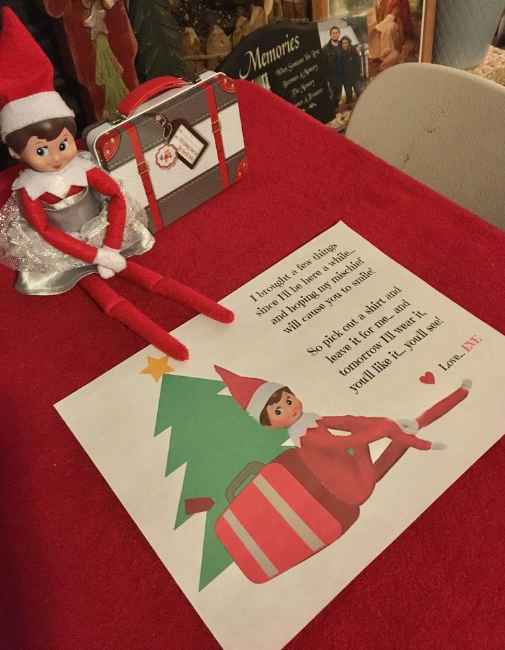 Day 2.  Eve the Elf brought a tiny suitcase with three t-shirts for her stay with us this month...  Elf on the Shelf.