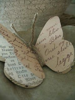Butterfly tag ~ 3 layers of vintage paper ~ book paper, sheet music & a handwritten letter (could use any paper, really) ...tied w/ twine....again, I would love leather, instead!