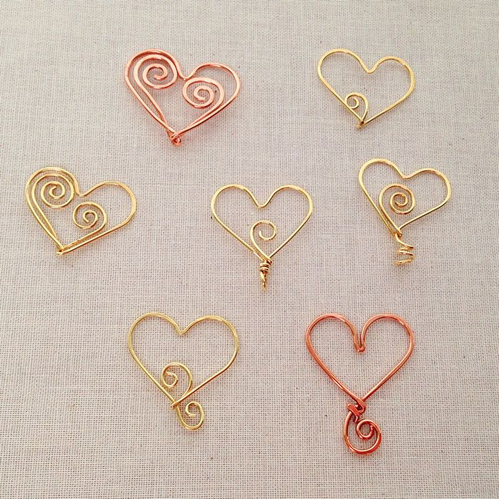 A variety of wire hearts that I made recently - practicing my curls and swirls.  Still not sure what I'll use them for...Lisa Yang's Jewelry Blog: DIY Beaded Heart Frame Necklace Pendant