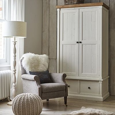 A Harris Tweed armchair looks so at home with whitewashed wood for a calm, tranquil space.