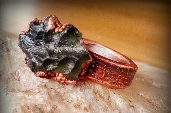 Check out this item in my Etsy shop https://www.etsy.com/listing/493103615/electroformed-ring-with-moldavit